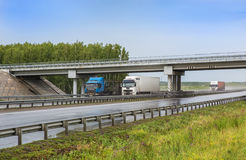 Trailers go on highway to rain Royalty Free Stock Photo
