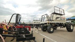Trailers for harvesters plows are parked for agricultural machinery. On the territory of the agricultural complex, the lower the angle, panoramic camera stock footage