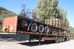 Trailers with wooden pallets. Of a warehouse or factory for shipping Stock Photos