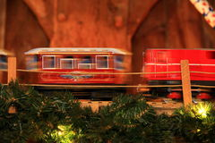 Trailers wooden toy locomotive vintage style gifts for Christmas and New Year storefront podakri under the tree Stock Images