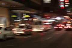 Trailing car and cityscape lights royalty free stock images