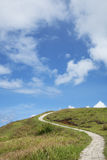 The trails in Lanyu. The trails with blue sky and white clouds in Lanyu Stock Images
