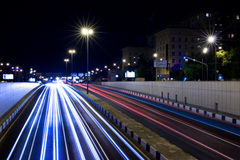 Trails of light. Busy avenue going down in tunnel; 30 seconds exposure in night Royalty Free Stock Photos