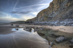 Trails. Local Welsh Beach scape just after sunrise, large reflections Royalty Free Stock Images
