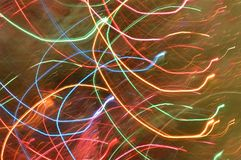 Abstract light trails rainbow colors. Trails of sparkling and colorful lights in rainbow colors - Christmas Tree lights during the holidays. Rainbow rain royalty free stock images
