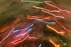Abstract light trails rainbow colors. Trails of sparkling and colorful lights in rainbow colors - Christmas Tree lights during the holidays. Rainbow rain Royalty Free Stock Photos