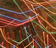 Abstract light trails rainbow colors. Trails of sparkling and colorful lights in rainbow colors - Christmas Tree lights during the holidays. Rainbow rain Royalty Free Stock Image