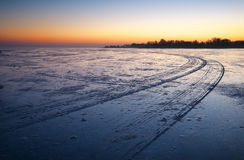 Trails on the surface of frozen lake. Royalty Free Stock Photos