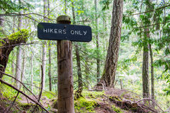 Trailsign. A wooden trail sign keeps hikers from getting lost Stock Photography
