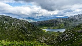 Lake among rocky hills. stock photography