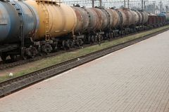 Train. Old rusty oil transporting freight train wagons Stock Photos