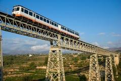Train. Narrow gauge train crossing a bridge in scenic location Stock Photos