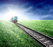 Train 15. A train, rut and grass Stock Image