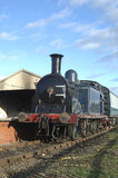 The train. Vintage steam train with carriages at station platform Stock Image