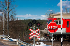 Train. The train crosses the railroad crossing Stock Images