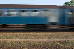 Train. Fast passenger train passing by with motion blur Royalty Free Stock Image