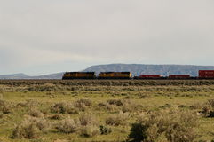 Train. Runnung across plains of wyoming with nothing else in sight royalty free stock photography