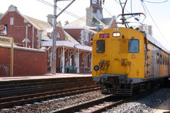 Train. Yellow public train pulling into the station at Muizenberg, South Africa Royalty Free Stock Photos