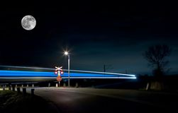 Train. View of night train lights and moon. Night shot. Space for text Stock Photography