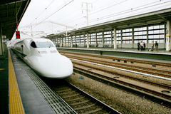 Train. Fast bullet train arriving at Kyoto station, Japan Royalty Free Stock Image