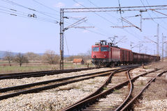 Train. Red old train on a railroad passing by Stock Photography