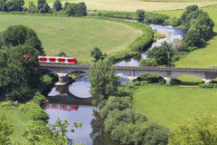 Train from above in the countryside. A passenger train from above in the countryside Stock Photo