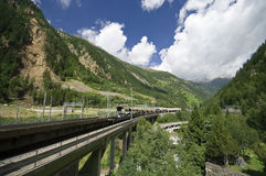 Train through Alps. Railway line going through Swiss Alps, the Lotschberg tunnel Stock Photo