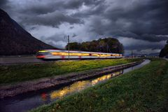 Train in the Alps. In the evening Royalty Free Stock Photo