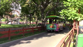 Train in amusement park. Funny train in an amusement park in a sunny day stock video footage