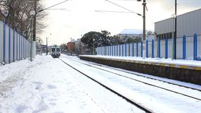 Train approaches the camera in snow stock footage