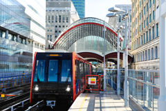 Train approaches docklands station in London. Train arrives at docklands station in London stock image