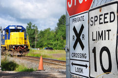 Train approaching crossing Stock Photography
