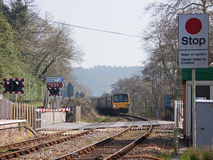 Train approaching a Level Crossing in Devon UK Royalty Free Stock Photo
