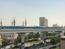Train approaching Oud Metha Metro Station in Dubai Royalty Free Stock Photography