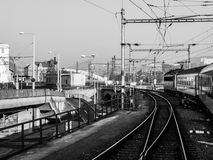 Train approaching railway station Royalty Free Stock Images