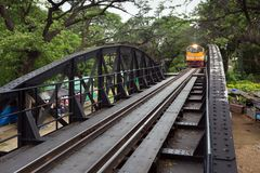 Train approaching on river kwai royalty free stock image