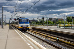 Train Approaching Station Stock Photo