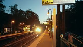 Train approaching station in evening (2 of 2). A view or scene of Transportion stock video