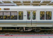 Train at Arashiyama station, Japan. KYOTO, JAPAN - NOVEMBER 24 : Side door of train stops at platform of Arashiyama train station in Kyoto, Japan, on November 24 Stock Photos