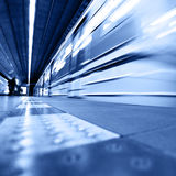 Train arrival. Train in motion blur arrival to underground station Stock Images