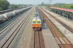 Train arrival at Kaeng Khoi Junction NO.3. Many kind of train to anticipate because it`s junction stock images