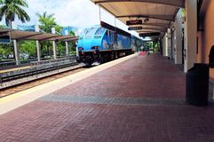 Train arrival in station perspective view Stock Photo
