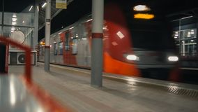 Train arrival to station. At night. Shallow depth of field stock footage