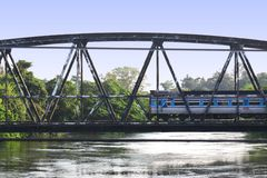Train arrive. The train arrive at the bridge across the river Royalty Free Stock Images