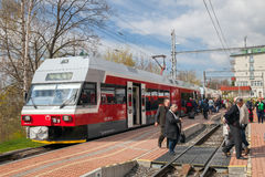 The train arrived on railway station in spring time Stock Images