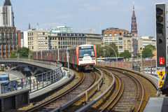 A train arrives at Baumwall Station im Hamburg Royalty Free Stock Photography