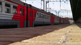 The train arrives at the railway station. Shooting at the low point. Lyubertsy, Moscow region, Russia. 6 Sep 2014. The train arrives at the railway station stock footage