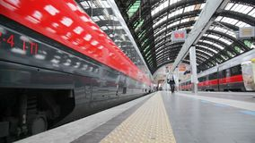 The train arrives at the station. High-speed train arrived at Milan Railway station. This type of trains on certain sections of the route reaches a cruising stock video footage