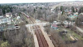 Train arrives at the station Lugovaya. Railway transport. Suburban electric train arrives at the Lugovaya station. Railway transport stock footage