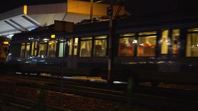 Train arrives at the station at night. Traveling tourism and visiting cities stock video